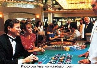 Roulette home page: Players at a roulette table.